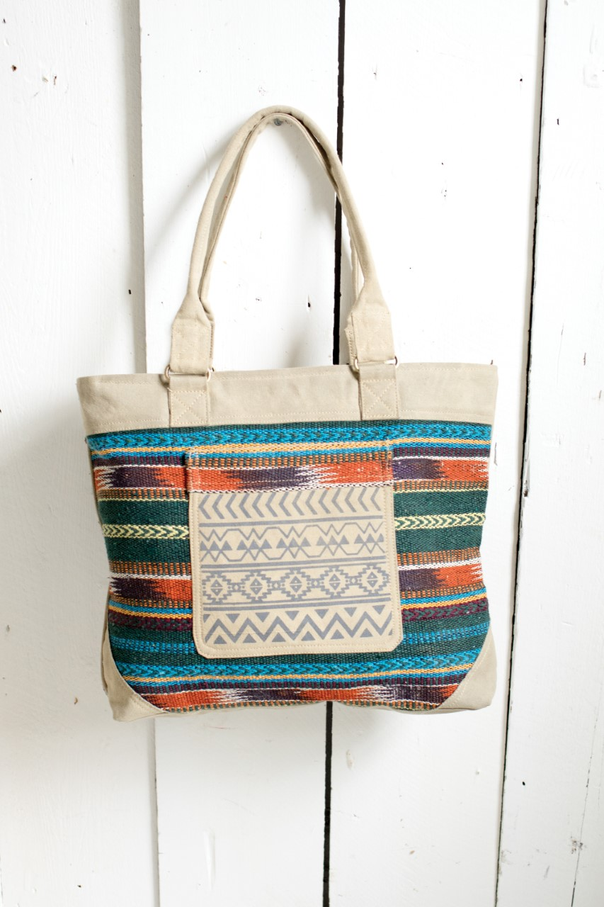 Canvas and cotton natural patterned zip fastening shoulder shopping/beach bag with pockets
