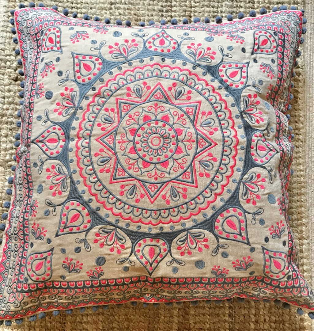 Pink and grey mandala design cushion with grey mini pom pom edging, in three sizes
